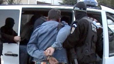 Poliţist reţinut